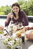Beautiful Woman Holding Wineglass At Dinner Party Royalty Free Stock Image