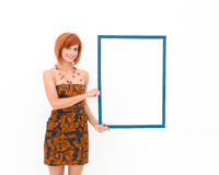 Beautiful woman holding wooden frame Royalty Free Stock Photo