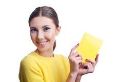 Beautiful woman holding yellow blank Stock Photo