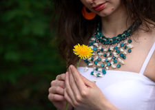 Beautiful woman holding yellow dandelion Royalty Free Stock Photos