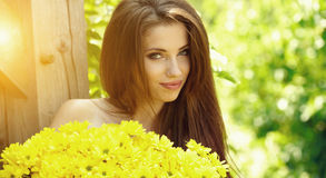 .Beautiful woman  Holding yellow flowers Stock Images