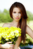 .Beautiful woman Holding yellow flowers Stock Photo