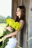 .Beautiful woman Holding yellow flowers Stock Photos
