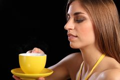 Beautiful woman holding yellow tea cup and saucer Royalty Free Stock Photo
