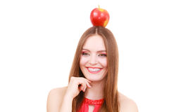 Beautiful woman holds apple fruit on head Stock Photography