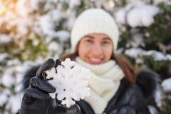 Beautiful woman holds a big snowflake winter Stock Photos