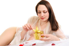 Beautiful woman holds a box with a gift Stock Image
