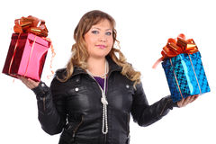 Beautiful woman holds boxes with gifts Stock Photos