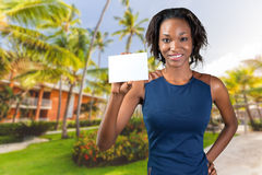 Beautiful woman holds a business card Royalty Free Stock Photo