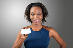 A beautiful woman  holds a business card Royalty Free Stock Photography