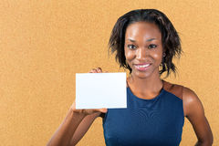 Beautiful woman holds a business card Royalty Free Stock Photos