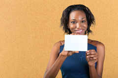 A beautiful woman holds a business card Royalty Free Stock Photo