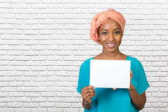 Beautiful woman holds a business card Stock Photo