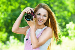 Free Beautiful Woman Holds Camera Royalty Free Stock Photos - 21253268
