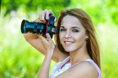 Beautiful woman holds camera Stock Photography