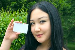 Beautiful woman holds card in hand Royalty Free Stock Photos