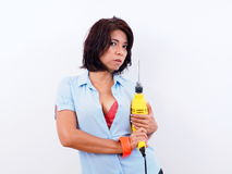 Beautiful woman holds electric drill Royalty Free Stock Images