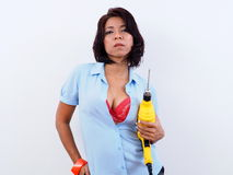 Beautiful woman holds electric drill Royalty Free Stock Photography