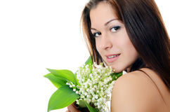 Beautiful woman holds a flower of a lily of the valley Royalty Free Stock Photos