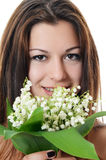 The beautiful woman holds a flower of a lily of the valley Stock Photo