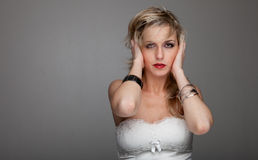 Beautiful woman  holds her head Stock Photo