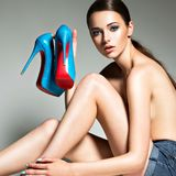 Beautiful woman holds high heels. Fashion young girl Royalty Free Stock Photo