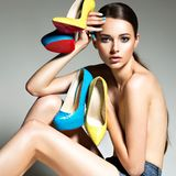 Beautiful woman holds high heels. Fashion young girl Stock Image