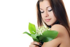 The beautiful woman holds  lily of the valley Royalty Free Stock Photos