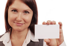 Beautiful woman holds out a business card Royalty Free Stock Image