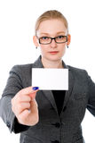 A beautiful woman holds out a business or credit card Stock Photo