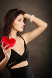 Beautiful woman holds red heart on black Royalty Free Stock Photography