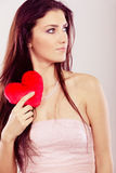 Beautiful woman holds red heart Stock Photos