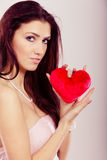 Beautiful woman holds red heart Stock Photo