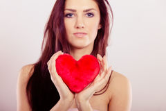 Beautiful woman holds red heart Royalty Free Stock Image