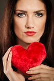 Beautiful woman holds red heart closeup Stock Images
