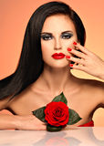Beautiful woman holds the red rose Stock Photography