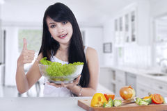 Beautiful woman holds salad Stock Photography
