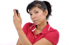 Beautiful woman holds smartphone Stock Images