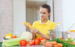 Beautiful woman holds  uncooked pasta Royalty Free Stock Photo