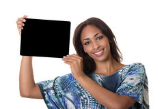 A beautiful woman holds up a tablet computer. Woman with a beautiful smile holds up a tablet computer Royalty Free Stock Photos