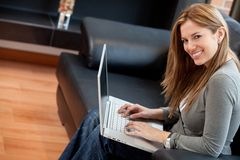 Beautiful woman at home Royalty Free Stock Image