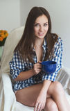 Beautiful woman at home drink coffee Stock Photography