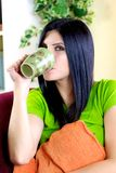 Beautiful woman at home having cup of tea Royalty Free Stock Photo