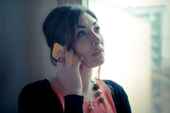 Beautiful woman at home at the phone Stock Photos