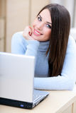 Beautiful woman at home using laptop Stock Photos