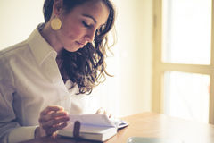 Beautiful woman at home writing and working Stock Photos