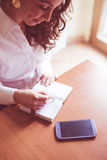 Beautiful woman at home writing and working Royalty Free Stock Photography