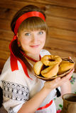 Beautiful woman with homemade cakes Royalty Free Stock Photos