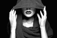 Beautiful woman in hood. Black and white portrait royalty free stock image