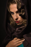Beautiful woman in a hood Stock Photography